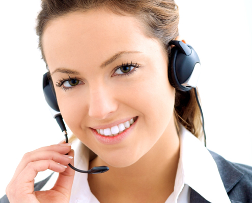 Women with a telephone headset on