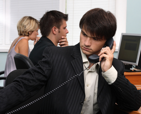 Person in a suit on the telephone
