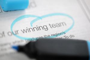 words winning team circled in blue marker