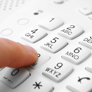"finger presses figure on phone. focus on ""five"""