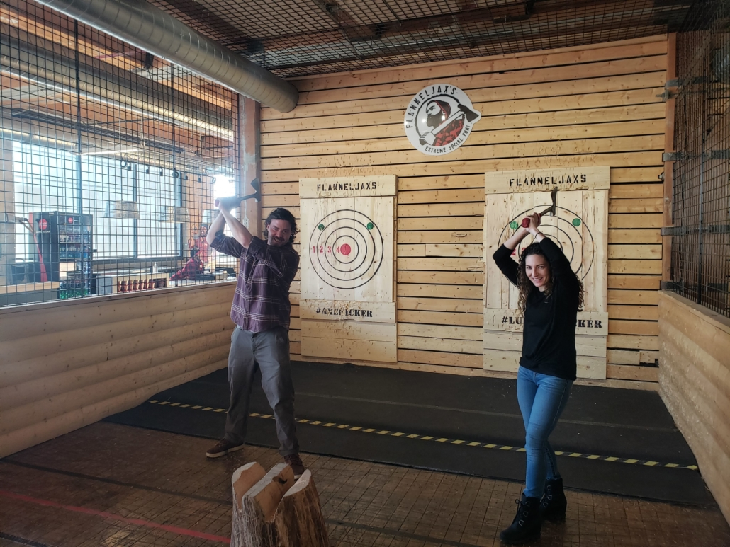 Search Leaders Staff throwing an axe at a target